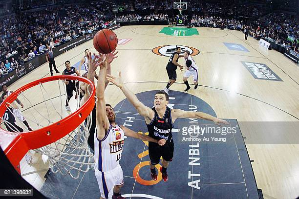Kirk Penney of New Zealand competes for the rebound against Tom Jervis of Brisbane during the round five NBL match between the New Zealand Breakers...
