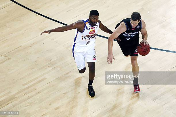 Kirk Penney of New Zealand drives against Jermaine Beal of Brisbane during the round five NBL match between the New Zealand Breakers and the Brisbane...