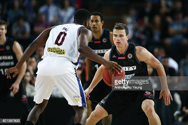 Kirk Penney of New Zealand sizes up on Jermaine Beal of Brisbane during the round five NBL match between the New Zealand Breakers and the Brisbane...