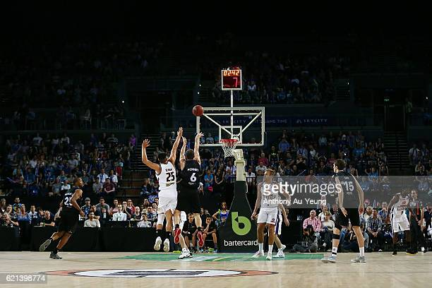 Kirk Penney of New Zealand takes a three pointer against Reuben Te Rangi of Brisbane during the round five NBL match between the New Zealand Breakers...