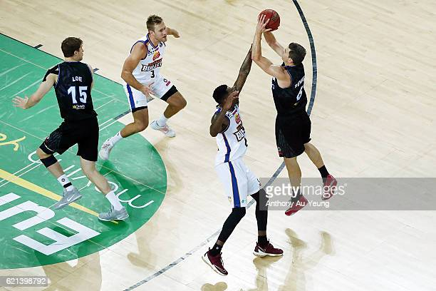 Kirk Penney of New Zealand takes a three pointer against Torrey Craig of Brisbane during the round five NBL match between the New Zealand Breakers...