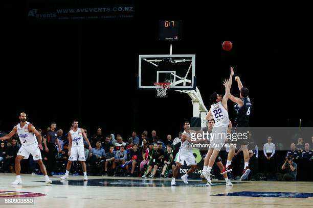 Kirk Penney of the Breakers forces up a three pointer against Dane Pineau of the Kings during the round two NBL match between the New Zealand...