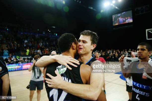 Kirk Penney of the Breakers shares a hug with teammate Mika Vukona after game two of the NBL semi final series between Melbourne United and the New...