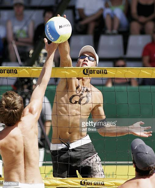 Kirk Pitman of New Zealand blocks the ball from David Kemplerer of Germany during the final on day three of the AAA NZ Open Beach Volleyball...