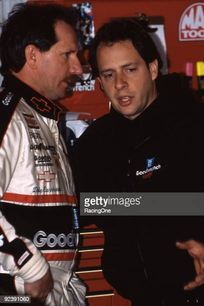 Kirk Shelmerdine crew chief for Dale Earnhardt Sr talks to Dale in the garage before a race circa 1990's