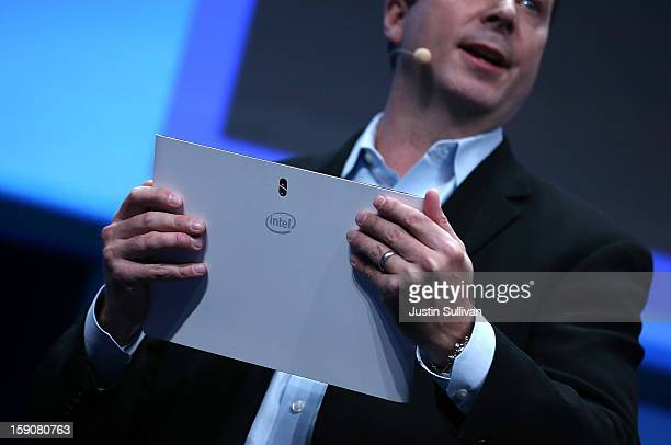 Kirk Skaugen Intel Vice President General Manager PC Client Group holds a prototype of a new Fourth Generation Intel Ultrabook during an Intel press...