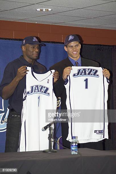 Kirk Snyder and Kris Humphries each hold up a jersey during a press conference which introduced the Utah Jazz 2004 draft picks on June 26 2004 at the...