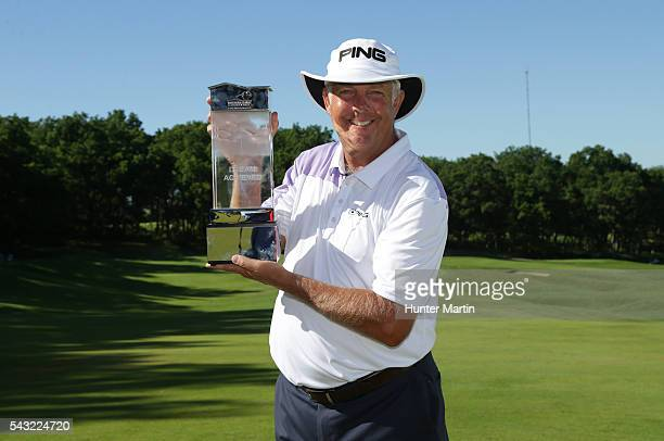 Kirk Triplett holds the championship trophy after winning the Champions Tour American Family Insurance Championship at University Ridge Golf Course...