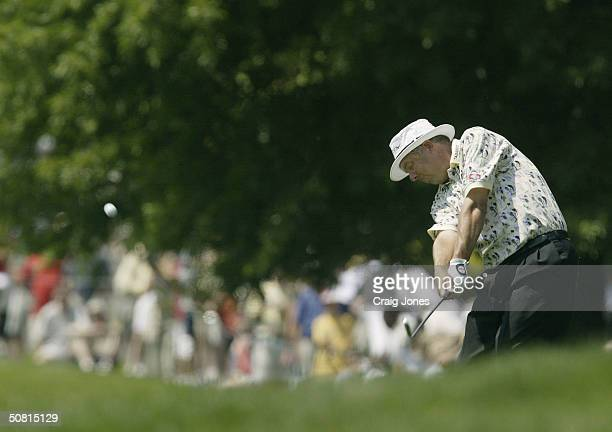 Kirk Triplett plays a shot from the rough on the seventh hole during the third round of the Wachovia Championship at the Quail Hollow Club on May 8...
