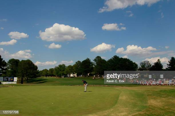 Kirk Triplett putts for birdie on the 18th green during the final round of the Knoxville News Sentinel Open at Fox Den Country Club on August 28,...