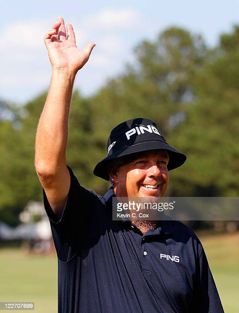 Kirk Triplett reacts after his par putt on the 18th green to win the Knoxville News Sentinel Open at Fox Den Country Club on August 28, 2011 in...