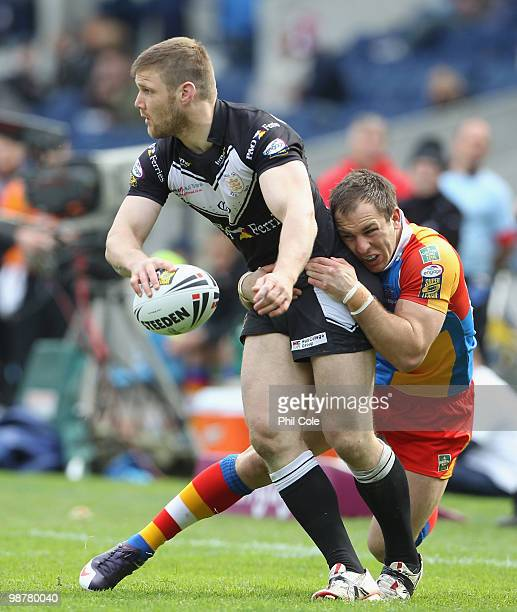 Kirk Yeaman of Hull FC gets tackled by Luke Gale of Harlequins during the Engage Rugby Super League Magic Weekend match between Hull FC and...