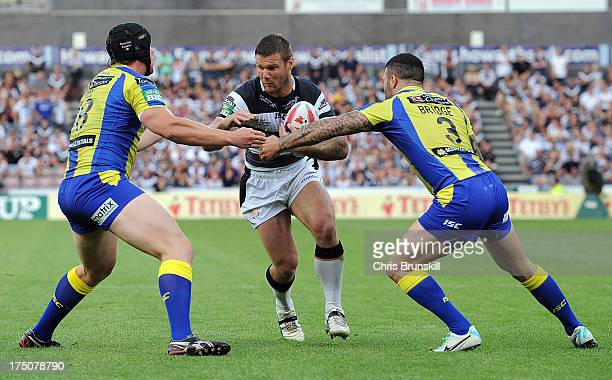 Kirk Yeaman of Hull FC runs at Chris Hill and Chris Bridge of Warrington Wolves looks on during the Tetley's Challenge Cup Semi Final between Hull FC...