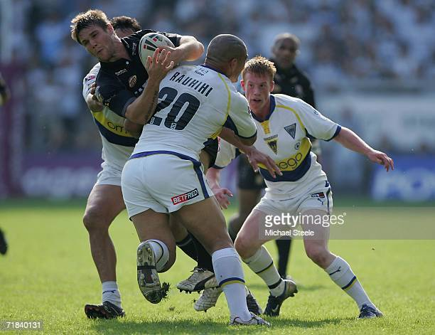 Kirk Yeaman of Hull is sandwiched between Paul Rauhihi Chris Riler and Logan Swann during the Engage Super League match between Warrington Wolves and...