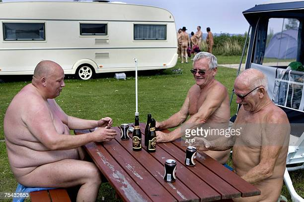 Asger Holger and John enjoy the summer weather and beers 16 July 2007 in the Solbakken naturist camp site in Kirke Hyllinge about 50 kilometers from...