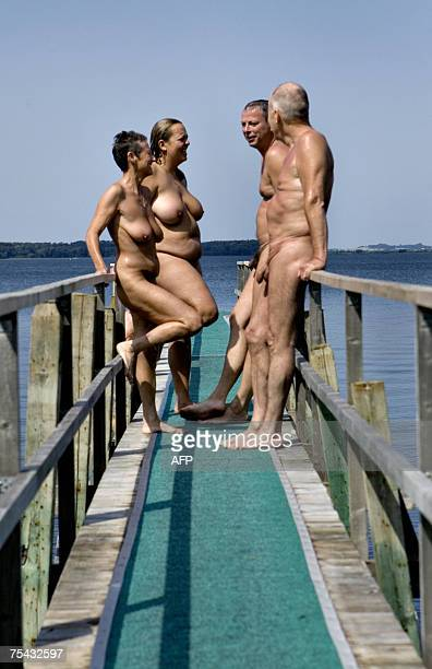 Danish bathers stand on a jetty 16 July 2007 in the Solbakken naturist camp site in Kirke Hyllinge about 50 kilometers from Copenhagen The camp the...