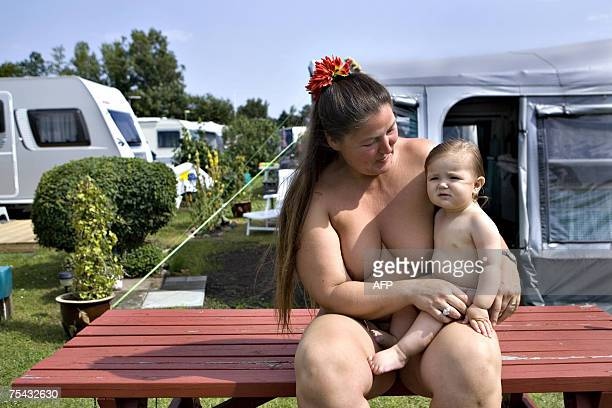 Tina and her daugther Lulu pose on a table 16 July 2007 in the Solbakken naturist camp site in Kirke Hyllinge about 50 kilometers from Copenhagen The...