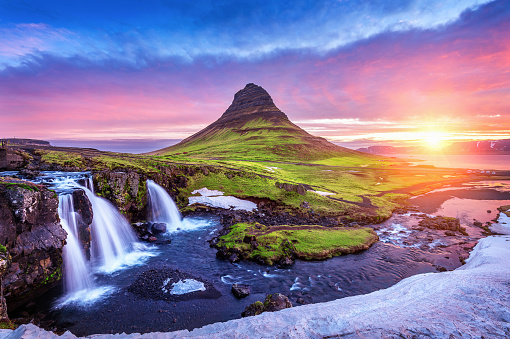 Kirkjufell at sunrise in Iceland. Beautiful landscape and sunrise. 940599896