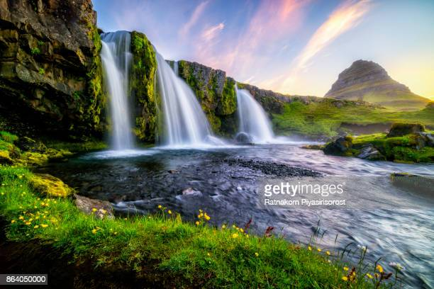 kirkjufell at sunrise in summer - waterfall stock pictures, royalty-free photos & images