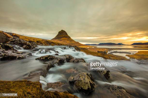 kirkjufell mountain and kirkjufellsfoss,sneafellsness, iceland - dramatic landscape stock pictures, royalty-free photos & images