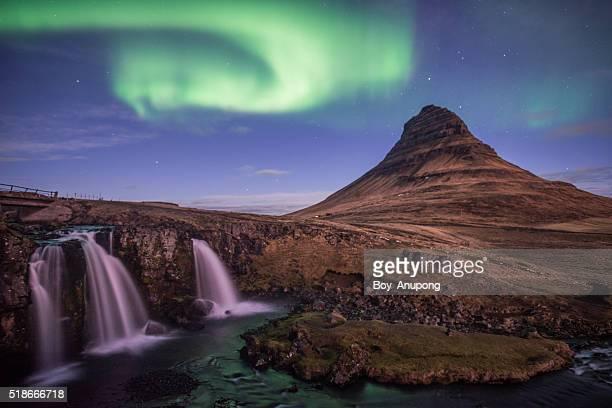 Kirkjufell mountain and the Aurora borealis in the wonderful night, Iceland.