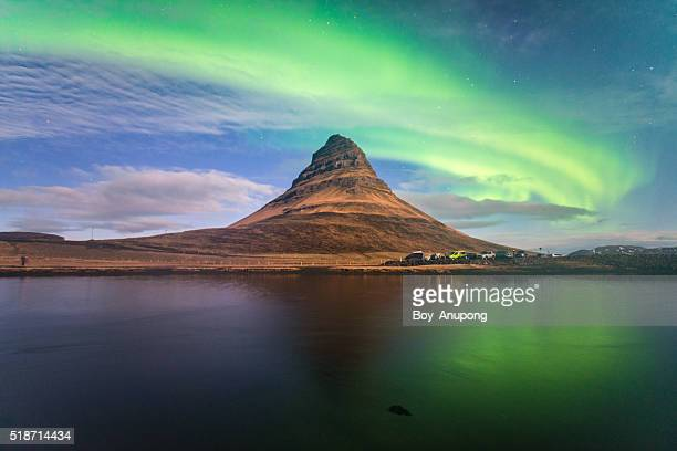 Kirkjufell mountain and the Aurora borealis in the wonderful night, Iceland.
