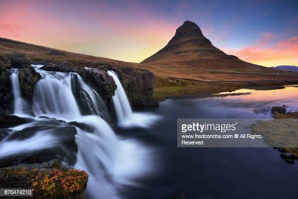 Kirkjufell mountain at sunrise located in Iceland