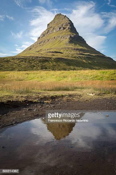 Kirkjufell Mountain reflecting on water