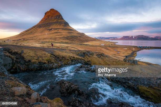 Kirkjufell the iconic tourist destination during the sunset in West region of Iceland.