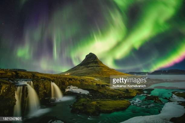 kirkjufell waterfall under aurora - north stock pictures, royalty-free photos & images