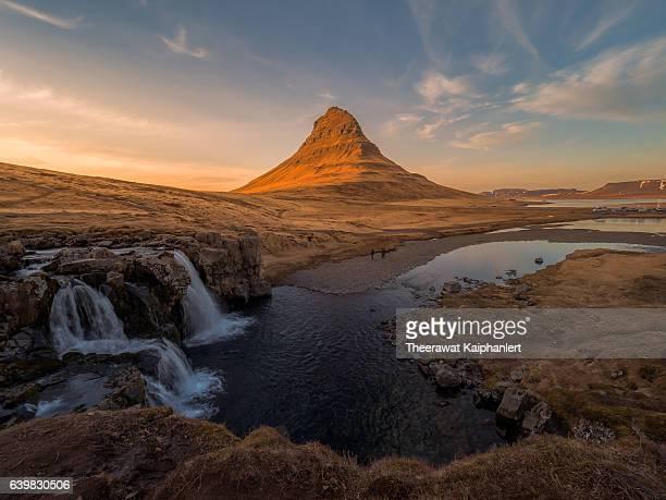 Kirkjufellfoss and Kirkjufell mountain during Sunset hour.