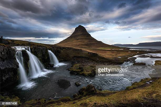 kirkjufellsfoss falls and kirkjufell mountain , snaefellsnes peninsula, iceland - louisville kentucky stock photos and pictures