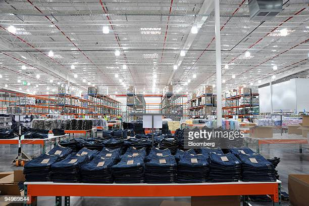 Kirkland brand jeans Costco's Wholesale Corp's private label are arranged on a dispay table as the new Costco warehouse is prepared for it's opening...