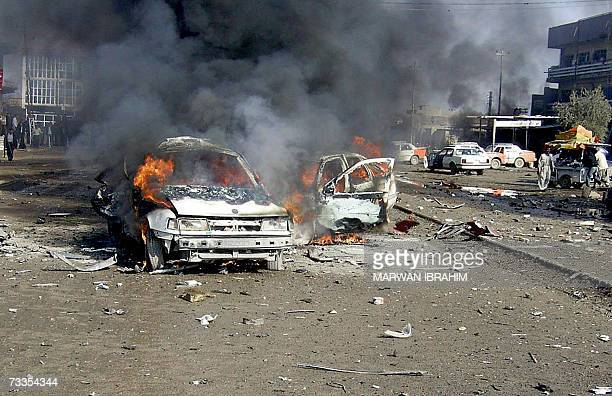 Fire flames rise from vehicles at the site where two car bombs exploded in quick succession at a garage in the oil rich city of Kirkuk north of...