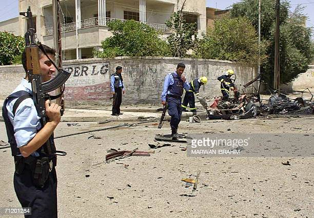 Iraqi policemen secure the site where a car exploded in the northern city of Kirkuk 14 June 2006 In Baghdad Iraqi Prime Minister Nuri alMaliki called...