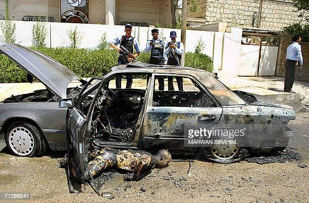 The burned body of Iraqi Brigadier General Mussa Hatem alHadidi head of counter terrorism intelligence service in the northern city of Kirkuk is seen...