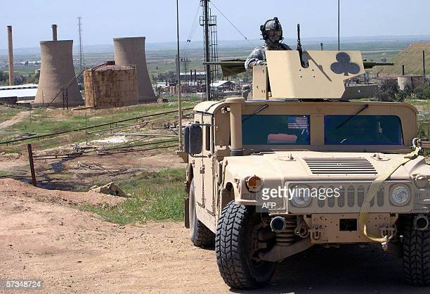 TO GO WITH A STORY BY PAUL SCHEMM A US army Humvee carrying soldiers from the 1st Brigade of the 101st Airborne division guard the premises of Iraq's...