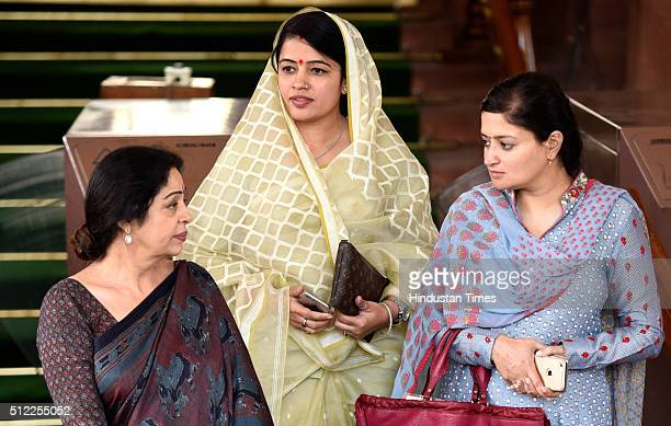 Kirron Kher BJP MP from Sidhi Riti Pathak BJP MP from Jamnagar Poonamben Madam after attending and listening to the Railway Budget 201617 in the Lok...
