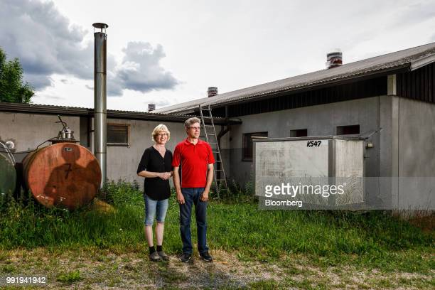 Kirsi Siikonen farmer left and Jouko Siikonen farmer right pose for a photograph on their family farm in Forssa Finland on Tuesday June 26 2018 On...