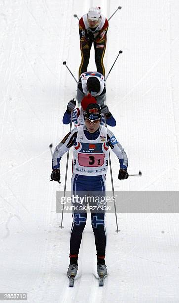 Kirsi Vaelimaa from Finland leads competitors during the 9th World Cup crosscountry women's 4 x 5km relay 11 January 2004 in Otepaa Norway won...