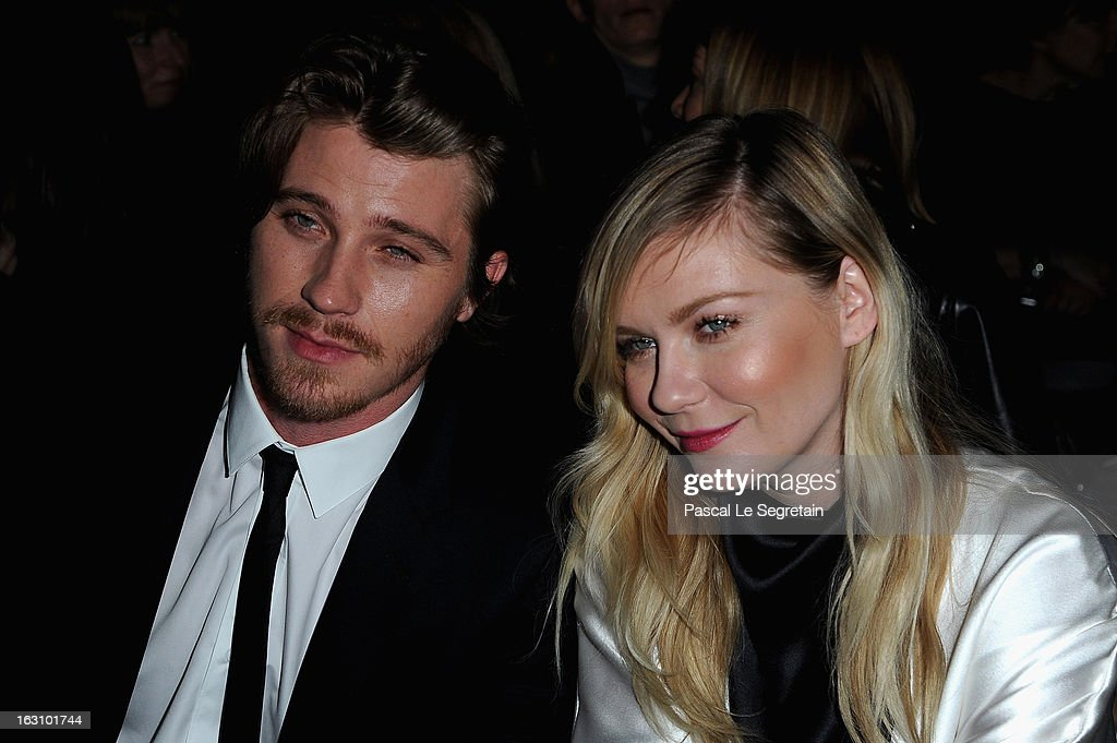Kirsten Dunst and Garrett Hedlund attend the Saint Laurent Fall/Winter 2013 Ready-to-Wear show as part of Paris Fashion Week on March 4, 2013 in Paris, France.