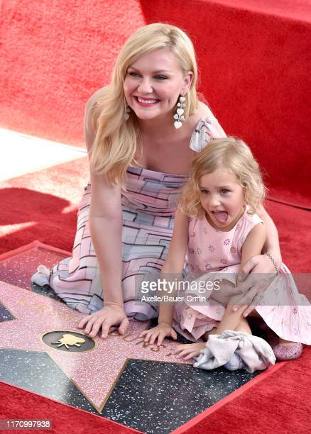Kirsten Dunst and goddaughter attend the ceremony honoring Kirsten Dunst with a Star on the Hollywood Walk of Fame on August 29 2019 in Hollywood...