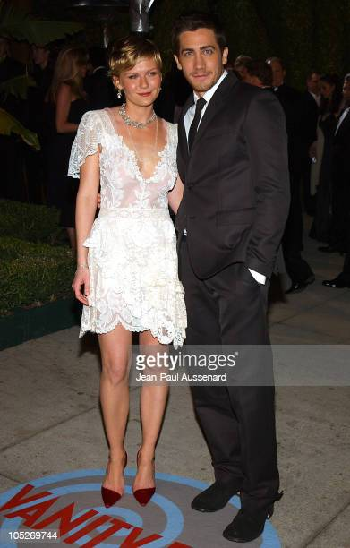 Kirsten Dunst and Jake Gyllenhaal during 2004 Vanity Fair Oscar Party Arrivals at Mortons in Beverly Hills California United States
