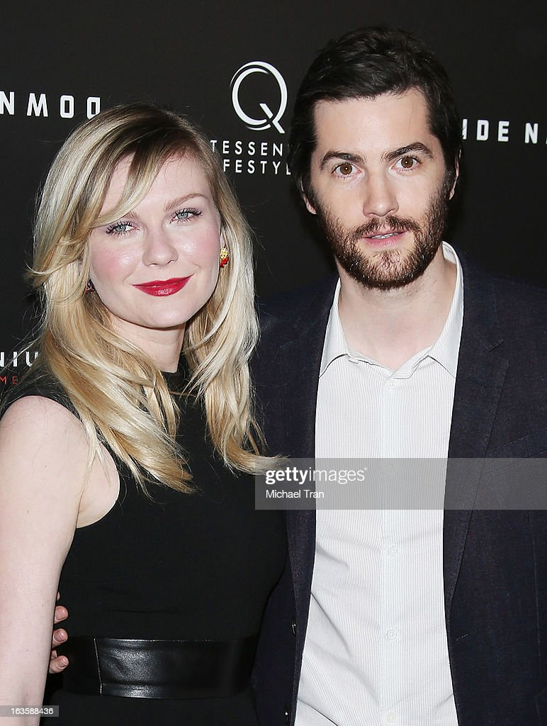Kirsten Dunst (L) and Jim Sturgess arrive at the Los Angeles premiere of 'Upside Down' held at ArcLight Hollywood on March 12, 2013 in Hollywood, California.