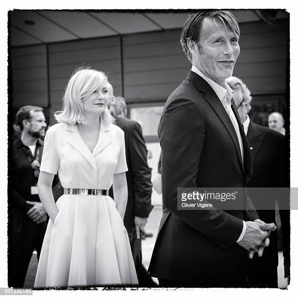 Kirsten Dunst and Mads Mikkelsen attend the Jury Photocall during the 69th annual Cannes Film Festival on May 11 2016 in Cannes France