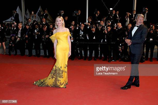 """Kirsten Dunst and Mads Mikkelsen attends the screening of """"The Neon Demon"""" at the annual 69th Cannes Film Festival at Palais des Festivals on May 20,..."""