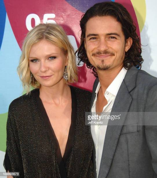 Kirsten Dunst and Orlando Bloom during 2005 MTV Video Music Awards White Carpet at American Airlines Arena in Miami Florida United States