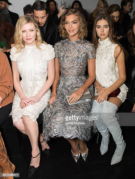 Kirsten Dunst Arizona Muse and Helena Gatsby attend the RalphRusso Haute Couture Spring Summer 2017 show as part of Paris Fashion Week on January 23...
