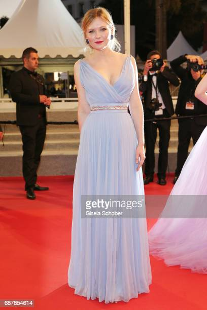 Kirsten Dunst departs the 'The Beguiled' screening during the 70th annual Cannes Film Festival at Palais des Festivals on May 24 2017 in Cannes France