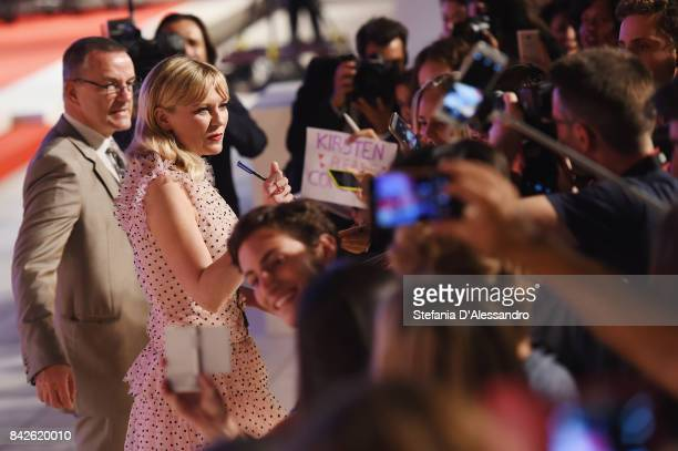 Kirsten Dunst from the movie 'Woodshock' signs autographs during the red carpet ahead of the 'Three Billboards Outside Ebbing Missouri' screening...